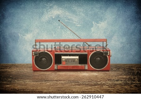 old retro radio on table blue background
