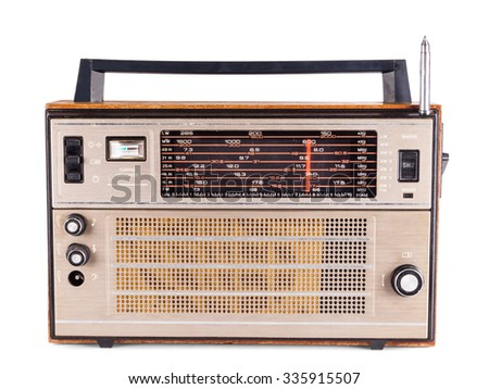 Old retro radio receiver with an antenna isolated on white background