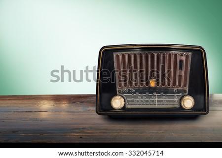 Old retro radio. Vintage or pastel effect photo. - stock photo