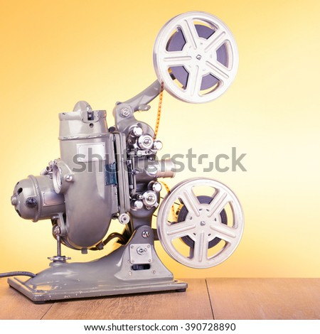 Old retro reel movie projector for cinema from 40s. Vintage style filtered photo  - stock photo