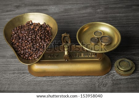 old retro scales on old wooden table with coffee beans - stock photo
