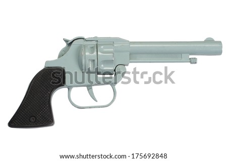 old retro toy pistol isolated on a white background