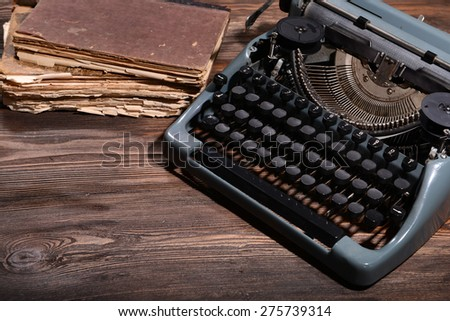 Old retro typewriter on table close-up