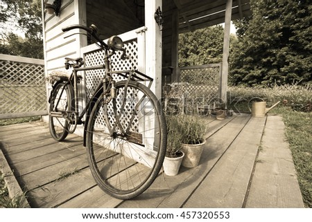 Old retro vintage bicycle on vintage wooden house wall