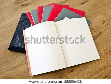 Old retro vintage paper books notebooks - stock photo