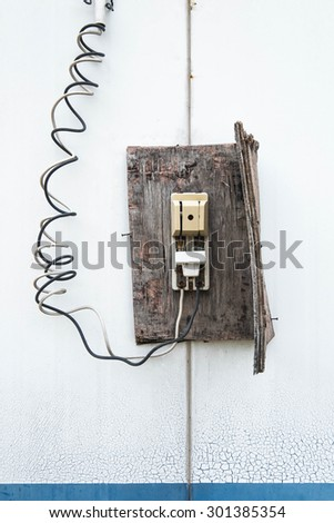 old retro wooden electric switch  - stock photo