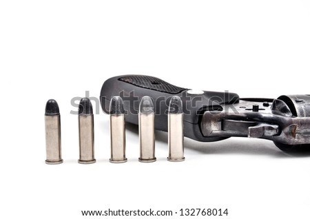 old revolver gun with bullet isolated on white background