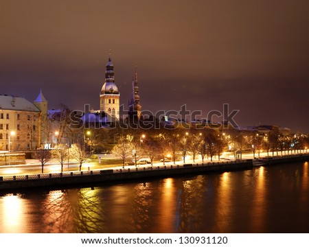 Old Riga by night. Coast of Daugava river - stock photo