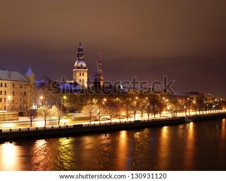 Old Riga by night. Coast of Daugava river - stock photo
