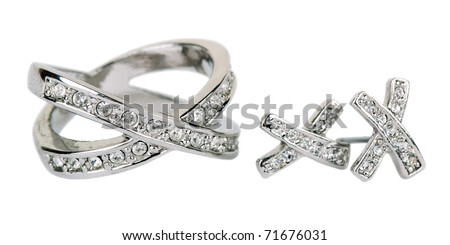 Old ring from white gold and an earring with jewels isolated on a white background - stock photo