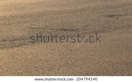 Old road background - surface of grey cracked asphalt texture  - stock photo