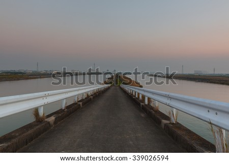 old road bridge at the river with beautiful twilight sky.