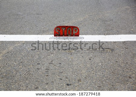 Old road stop sign mounted on asphalt - stock photo