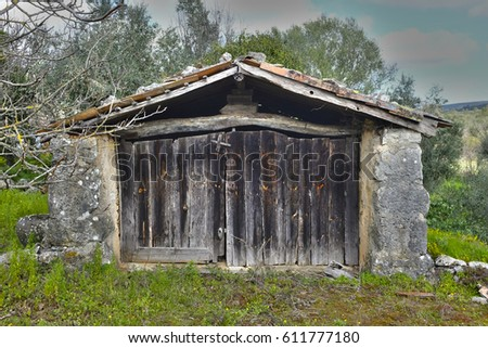 Old rock and wooden shed