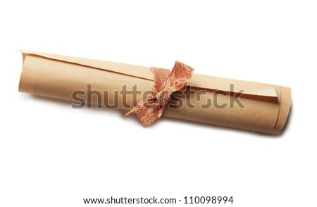old rolled paper tied with golden ribbon