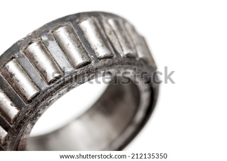 old roller bearing with traces rust, isolated on white background. - stock photo