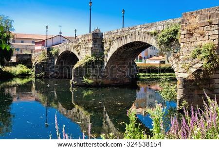 old Roman bridge in Monforte de Lemos, Galicia, Spain - stock photo