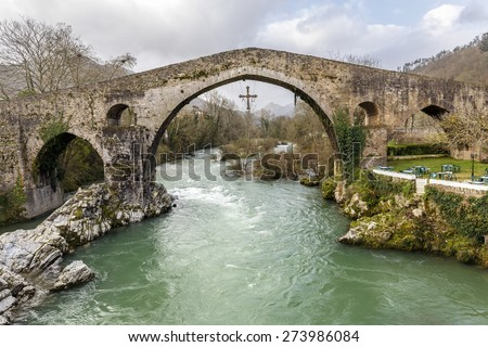Old Roman stone bridge in Cangas de Onis, Spain  - stock photo