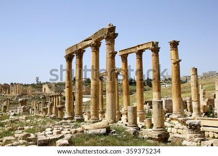 Old Roman street with stone pillars in Jerash, Jordan - stock photo