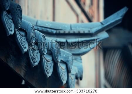 Old roof closeup in Lijiang, Yunnan, China. - stock photo