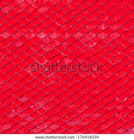 Old roof tiles made of terracotta as background - stock photo