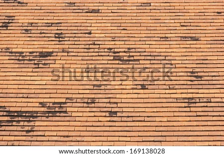Old roof tiles made of terracotta,  roof tiles background. - stock photo