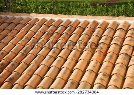 Old roof tiles on the roof of an old house - stock photo