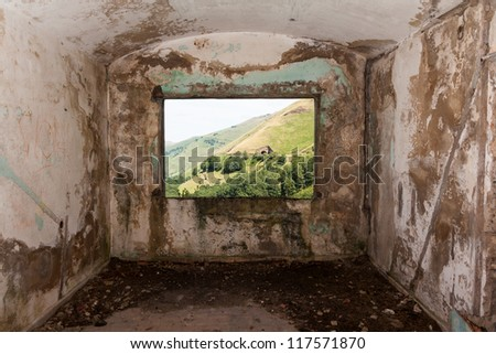 Old room and a landscape view through the window in Peaks of Europe  (Picos de Europa). Vega de Pas, Cantabria (Spain)