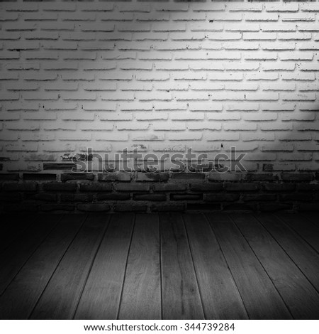 old room with brick wall black and white