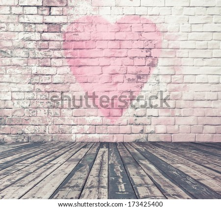 old room with brick wall graffiti heart, valentines day background - stock photo