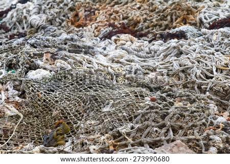 old rope fishing net trawl - stock photo