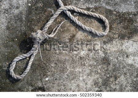 old rope on cement floor
