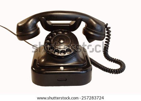 Old rotary phone on white background - stock photo