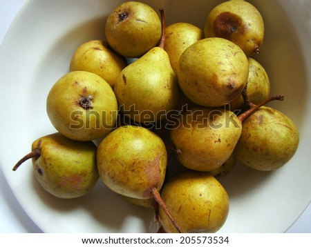 old, rotten organic yellow pear - stock photo