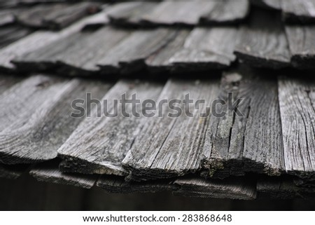 Old rotten wooden roof. Black - white background. - stock photo