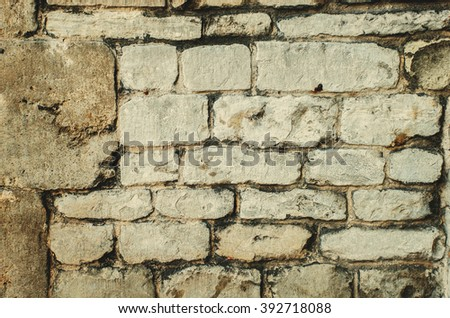 Old rough stone rock brick castle wall.  - stock photo