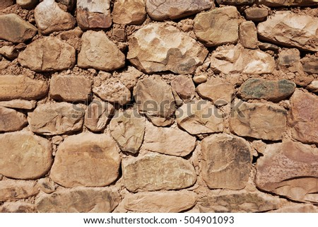 Old rough stone wall, background wallpaper