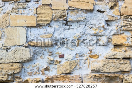 old rough wall made of brick and cement