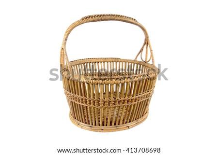 Old round rattan basket isolated on white background - stock photo