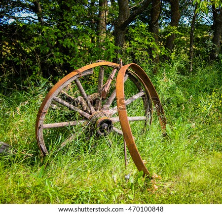 Old round wagon wheels on an abandoned farm in Manitoba Canada