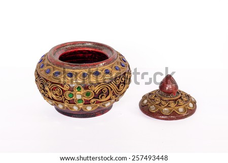 old round wood casket with jewelry isolated on white background - stock photo