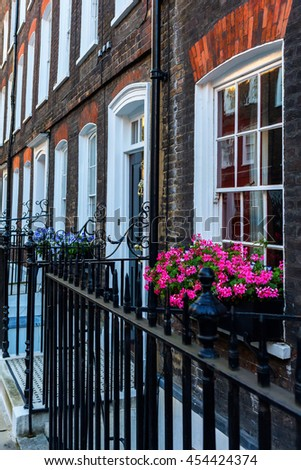 old row houses with flower decorated windows in Westminster, London, UK - stock photo