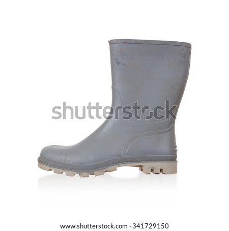Old rubber boot isolated on white background - stock photo