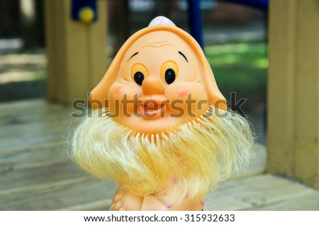 Old rubber toy in form of a bearded gnome for young children