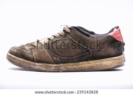 Old rugged shoe. - stock photo