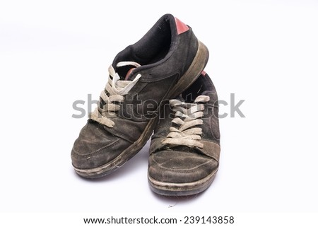 Old rugged shoes. - stock photo
