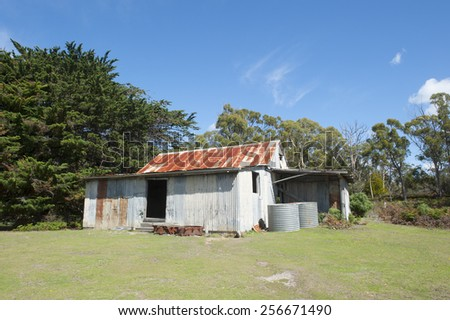 Old ruin building of French Farm on World Heritage Site Maria Island, Tasmania, Australia, a convict settlement in the 19th century, now National Park and tourist destination, blue sky and copy space. - stock photo