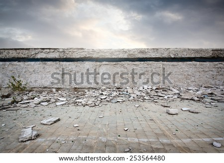 Old ruined abandoned swimming pool - stock photo
