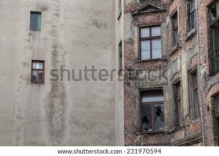 Old ruined and abandoned city house - outdoor shoot  - stock photo