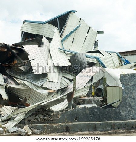old ruined buildings of metal warehouse. - stock photo